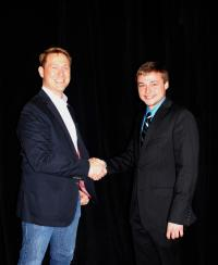 Drew Jenkins shakes hands with Anthony Moellers, first recipient of the Lisa Shepherd Jenkins Memorial Scholarship